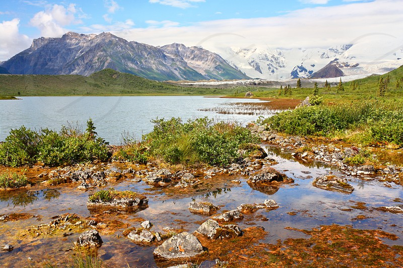 The Donoho Lakes in Wrangell-St.Elias National Park Alaska.  Mount Blackburn is seen in the distance 14 miles away. photo