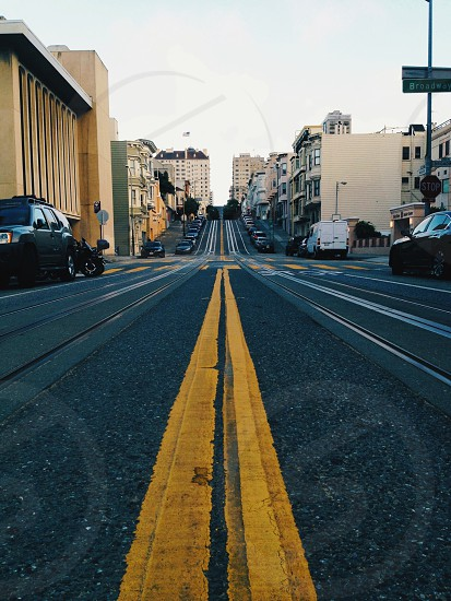 grey concrete road with yellow line photo