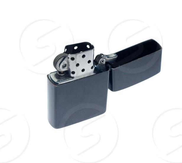 black zippo lighter openedisolated over white background photo