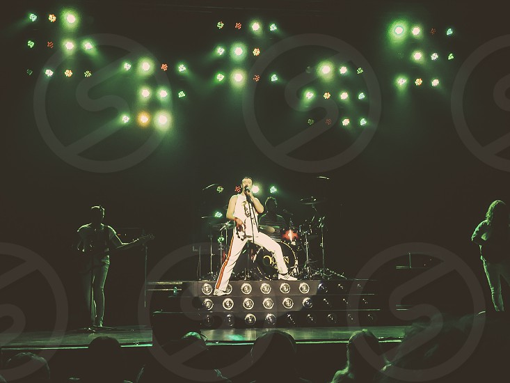 Classic rock One night of Queen tribute Freddie Mercury Brian May John Deacon Roger Taylor music lights the show must go on legends nostalgia photo