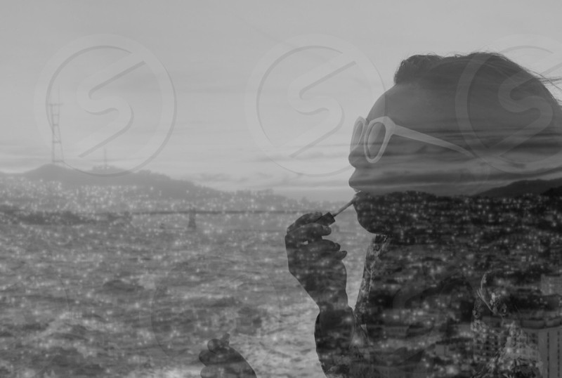 woman in white sunglasses and aerial city in double exposure photography photo