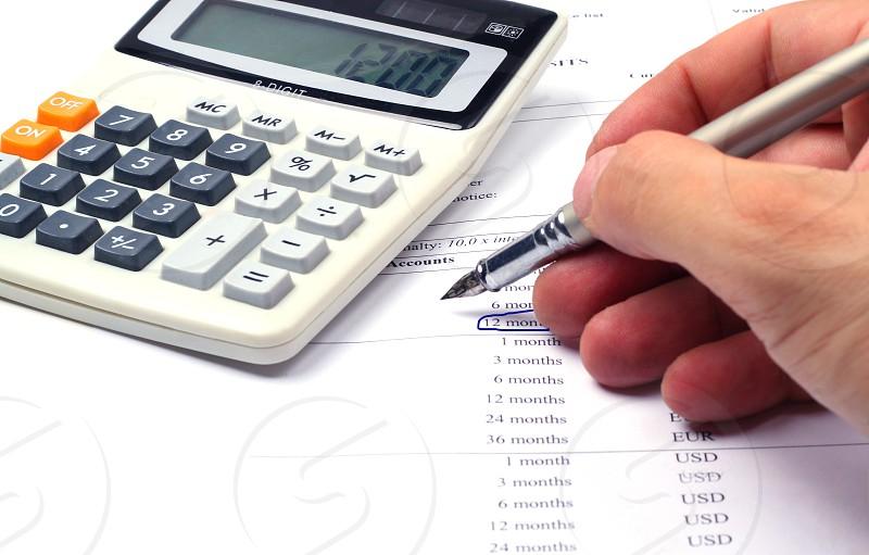 Bankingcalculatorhandpenaccounttaxes photo