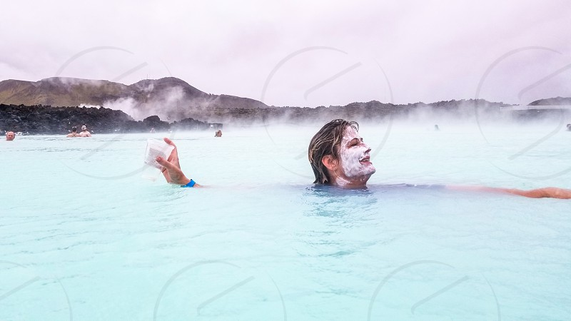 Relaxing in a geothermal pool in Iceland photo