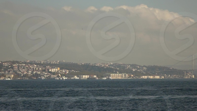 Picturesque panoramic view of cityscapes of Istanbul Bosphorus strait with marine traffic 15 July Martyrs Bridge in summer sunny day. Slow motion Full HD video 240 fps 1080p. photo