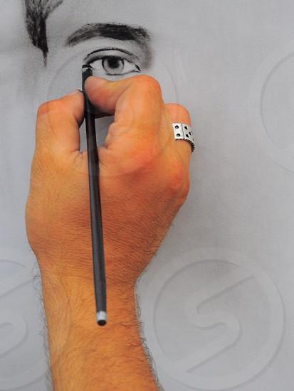 person sketching human eye photo