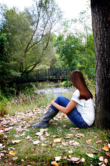 Relaxing in the park by a tree is such a good way to dream photo