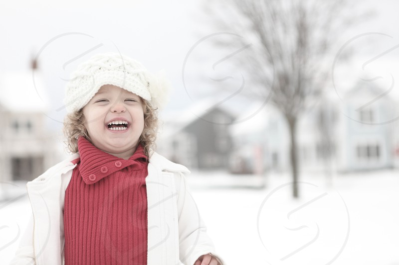 girl in white jacket smiling photo