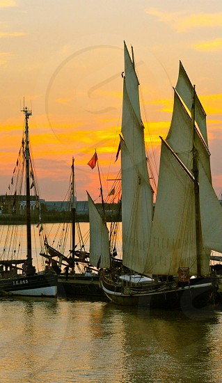 Boats sailboats tall ships Greenwich sunset thames london photo