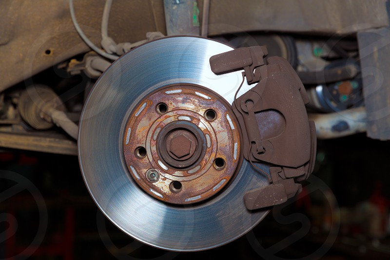 Car wheel brake rusty disc with pads rotor disc and caliper assembly photo