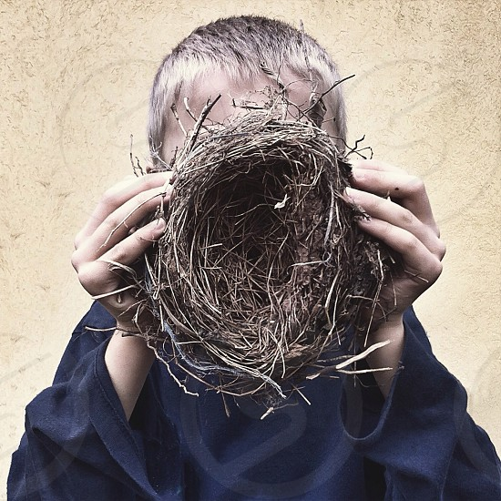 boy holding a bird's nest photo