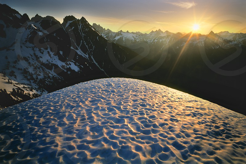 Sunrise from the top of a snow capped mountain in the Cascades. photo
