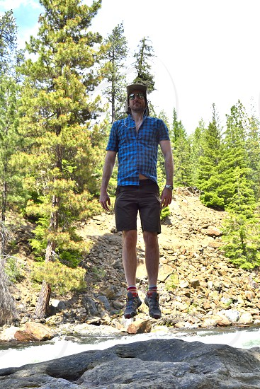 levitation jump hiking outdoors mountains river hiker photo