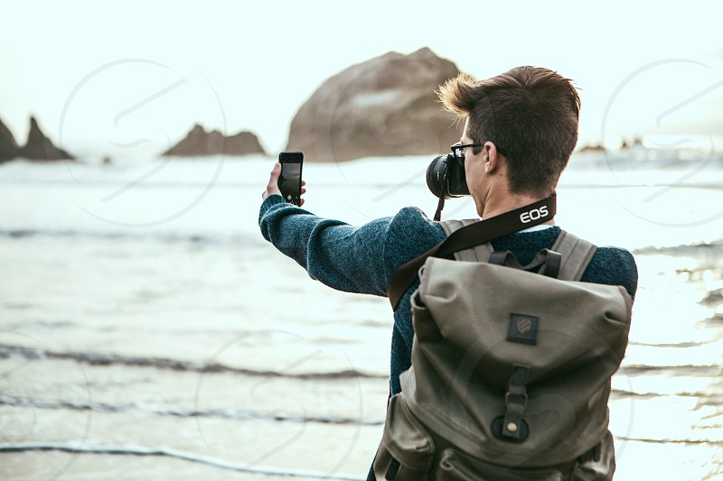 man taking a picture of his smartphone photo