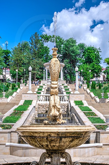 Chisinau Moldova – 06.28.2019. Fountains and the cascading stairs near the Valea Morilor Lake in Chisinau Moldova on a sunny summer day photo