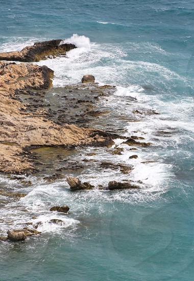 Mediterranean Sea and cliffs of the Ligurian coast of Ventimiglia in the area of Balzi Rossi photo