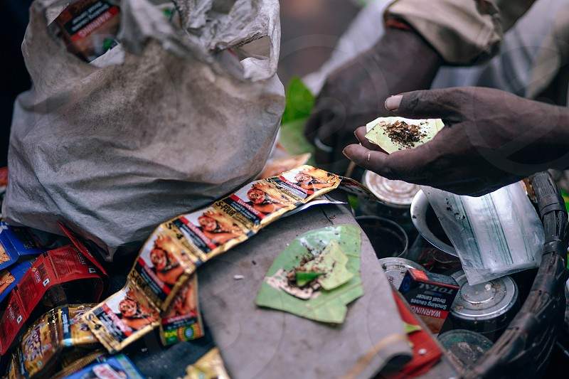 Betel leaves are mixed with ground nuts and optionally tobacco. Also called Paan is popular across India as mouth freshener photo