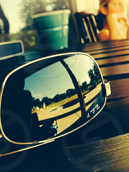 Ray-Ban sunglasses on wooden surface photo