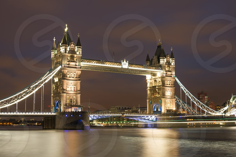 London Tower bridge on sunset illuminated with different colors photo