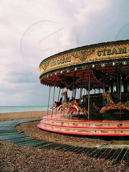 pink green and beige carousel photo