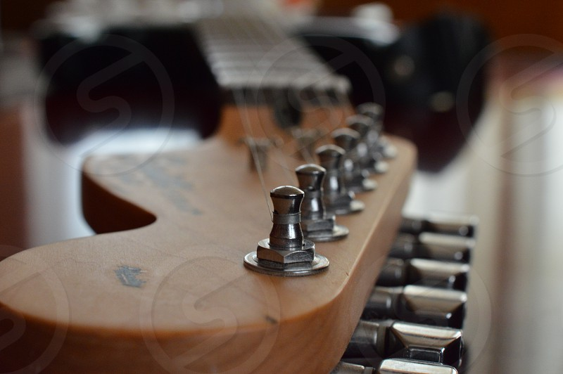silver guitar pins and strings photo