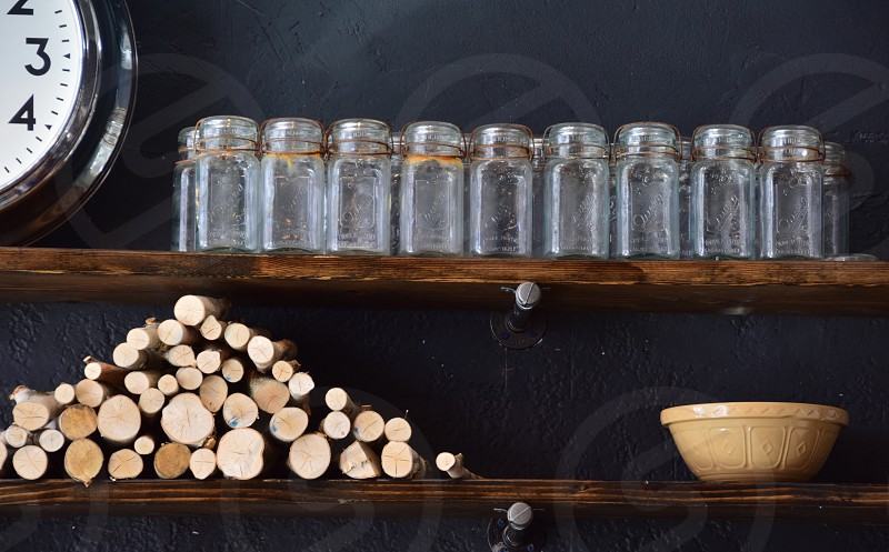 Collectible antique glass jars in rustic scene photo