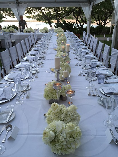 Weddings Hawaii table settings dinner party white silver flowers roses candles tent turtle bay resort photo