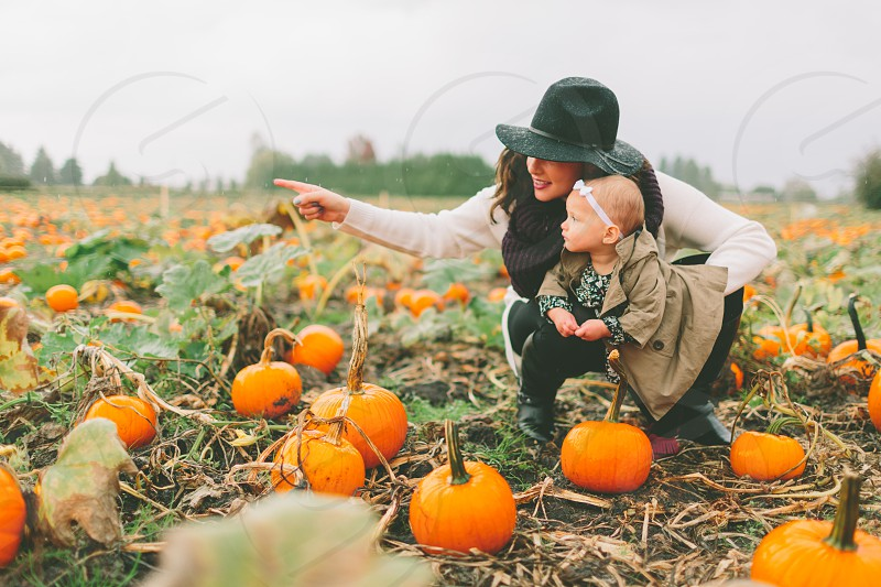 A mother and daughter at the pumpkin patch. photo