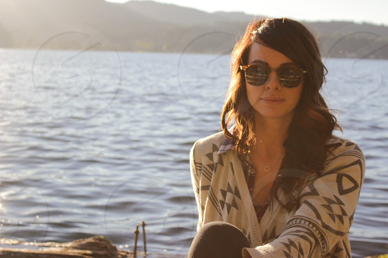 woman in gray and white cardigan wearing black sunglasses photo