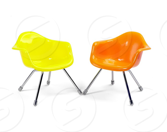 coulored plastic chairs isolated on white background photo