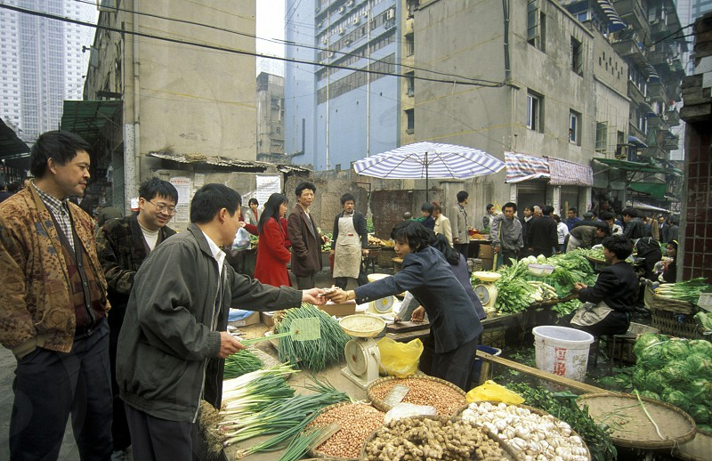 a market street in the city of Chongqing in the province of Sichuan in china in east asia.  photo