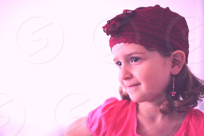 little girl with a red lace hat photo