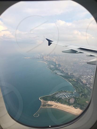 airplane window photo of city photo