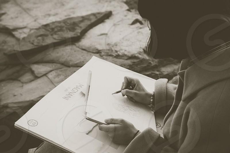 Girl drawing a cartoon photo