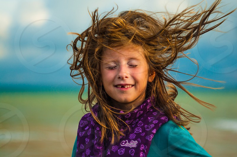 Girl with developing hair in the wind photo