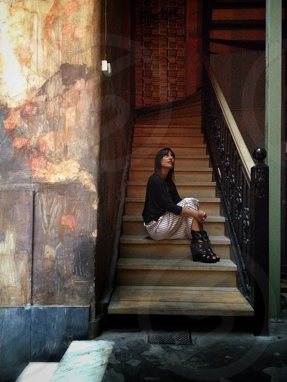 woman sitting on stairs photo