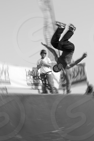 black and white photo of a man doing  side flip photo