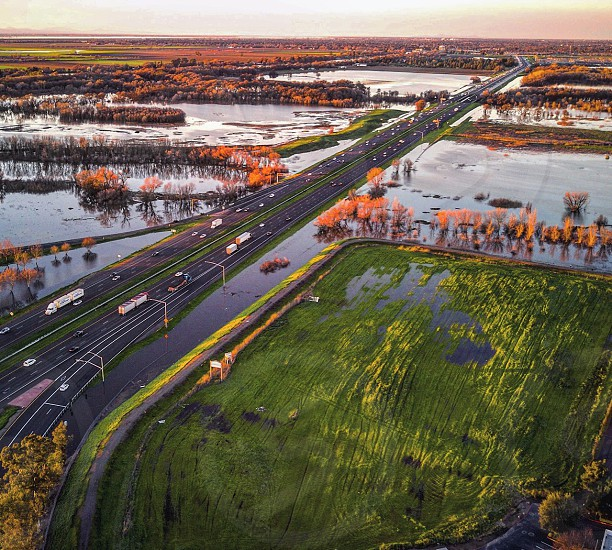 aerial drone road freeway water flood  photo