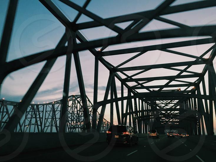 gray bridge under blue sky photo