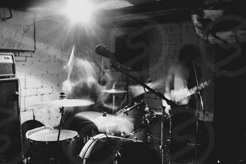 black and white drum set and microphone photo