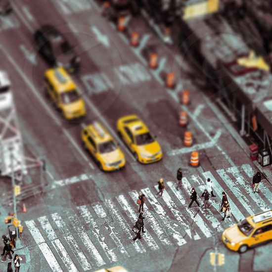 people walking on pedestrian lane in tilt shift lens photography photo