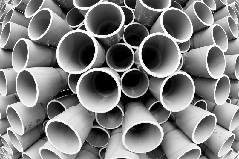 A stack of pvc conduit from a fish-eye perspective. photo