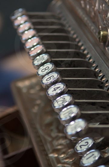 Closeup of the keys on an old cash register photo
