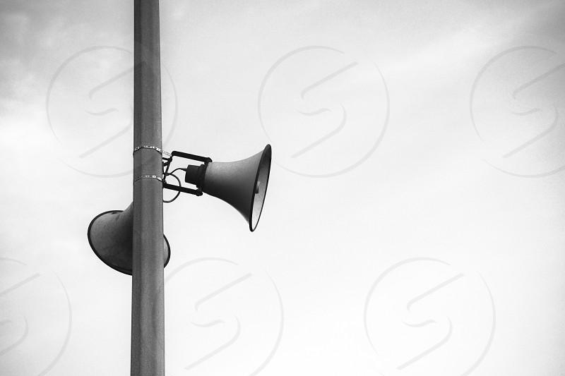 street post with loud speakers photo