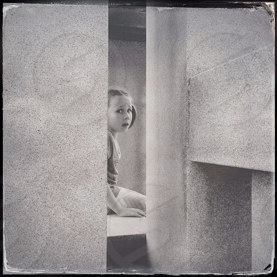 girl sitting near the door photo