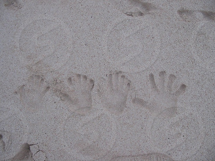 four handprints in the sand photo