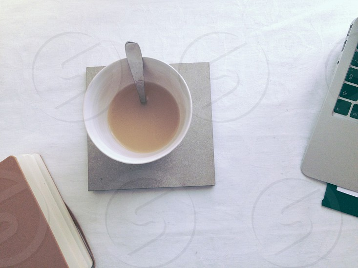 Tile table and cloth protection for tea cup photo