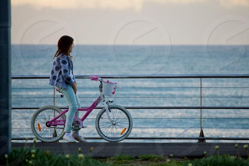 Girl beach bicycle  photo