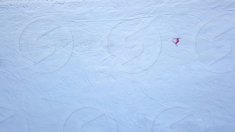 A woman in a pink jacket is skiing people are going down the slope. 4K video 240fps 2160p. photo