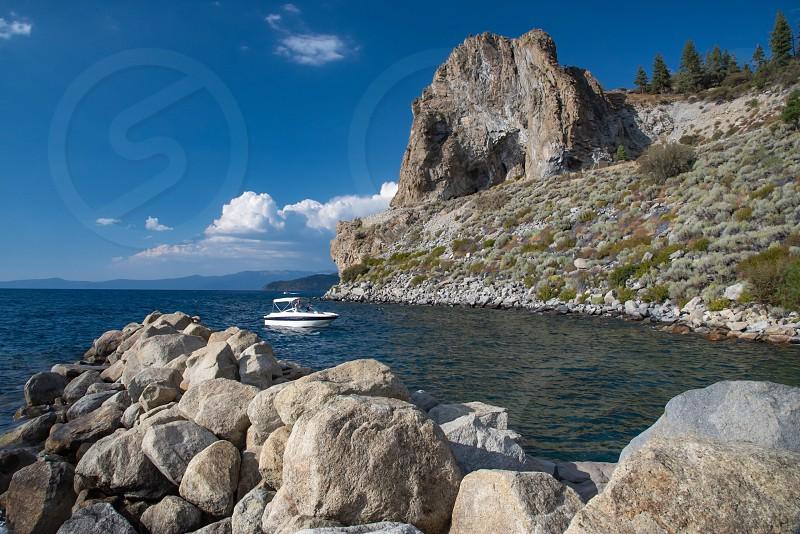 Cove mountain rocks boat lake inlet photo