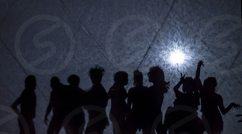 Silhouettes back light 80's hair dancing photo
